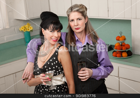 Pair of Women Enjoy A Drink stock photo, Two middle-aged Caucasian women drink in a retro-style kitchen by Scott Griessel