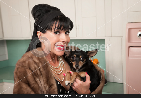 Woman with Dog stock photo, Smiling middled-aged woman in fur coat with pet Chihuahua dog by Scott Griessel