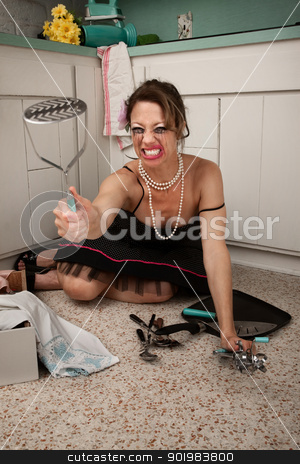 Crying Woman stock photo, Crying housewife on kitchen floor with masher in hand by Scott Griessel