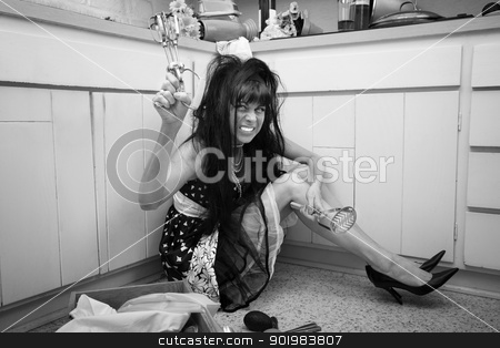 Mad Housewife stock photo, mad housewife on kitchen floor with egg beater and masher by Scott Griessel