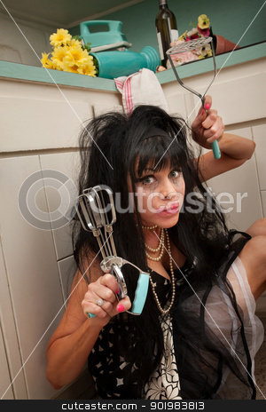 Woman Holds an Egg Beater and Masher stock photo, Drunk retro-styled woman with smeared mascara holding an egg beater and masher in kitchen  by Scott Griessel