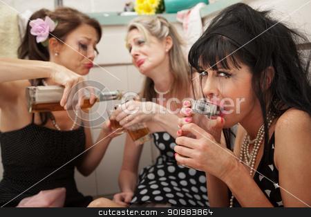 Weeping Woman Drinking  stock photo, Mascara-smeared, drunk, sobbing women on kitchen floor by Scott Griessel