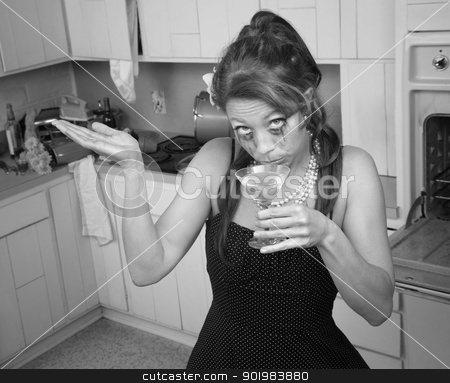 Weeping Woman Having A Drink stock photo, Woman with smeared mascara sips cocktail in retro-style kitchen by Scott Griessel