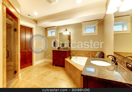 Large bathroom interior with high end quality. stock photo, Beautiful large bathroom with two sinks and tub. by iriana88w
