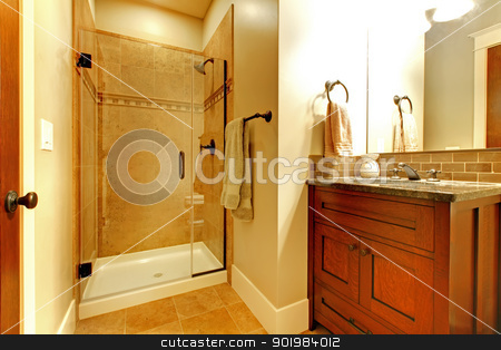 Bathroom with wood cabinet and tile shower. stock photo, Bathroom with wood cabinet and tile shower with golden tone. by iriana88w