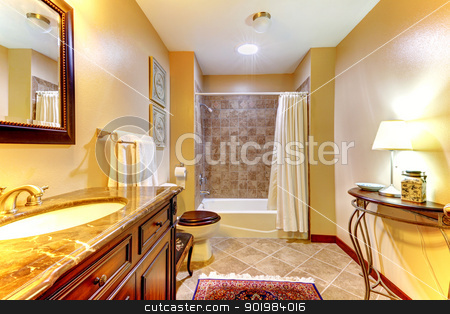 Golden nice bathroom with brown tiles and wood cabinet. stock photo, Golden nice bathroom with brown  ceramic tiles and wood cabinet. by iriana88w