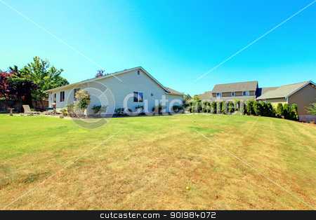 Small white house and shed with flowers. stock photo, American farm with smal white house and shed. by iriana88w