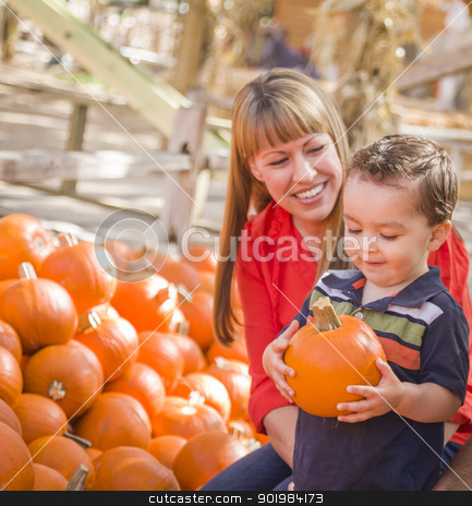 Happy Mixed Race Family at the Pumpkin Patch stock photo, Happy Mixed Race Family Picking Pumpkins at the Pumpkin Patch. by Andy Dean