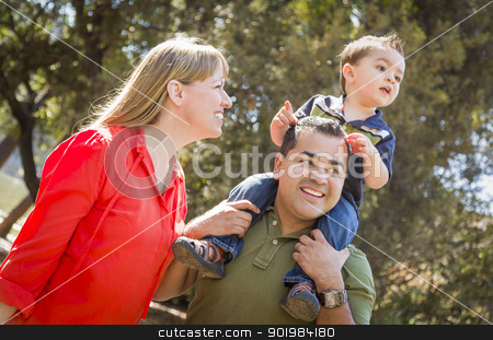 Mixed Race Family Enjoy a Walk in the Park stock photo, Happy Mixed Race Family with Enjoy a Walk in the Park. by Andy Dean