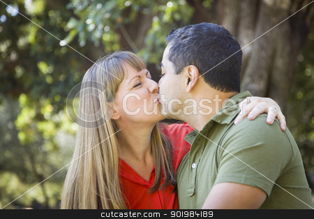 Attractive Mixed Race Couple Enjoying A Day At The Park stock photo, Happy Attractive Mixed Race Couple Enjoying A Day At The Park Together by Andy Dean