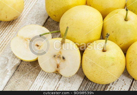 asian pears stock photo, asian pears from home garden on grunge wood background by Marek Uliasz