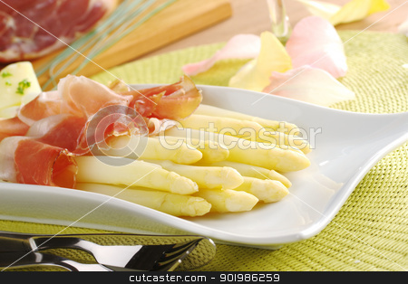 White Asparaus with Ham stock photo, Fresh cooked white asparagus served with ham (Selective Focus, Focus on the front of the asparagus on the left) by Ildi Papp