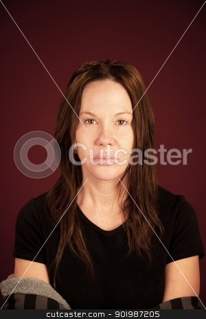 Serious Woman  stock photo, Serious woman isolated on maroon background by Scott Griessel
