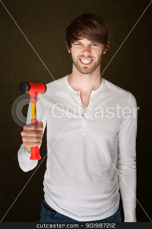 Man Holds Mallet stock photo, Smiling young Caucasian male with red mallet by Scott Griessel