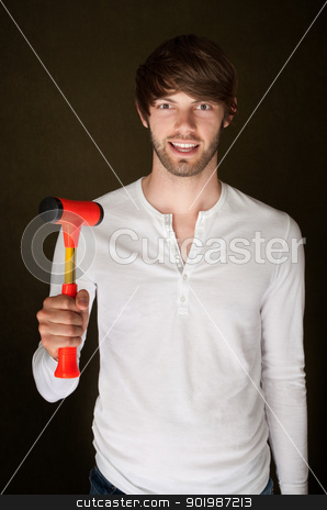 Man With Mallet stock photo, Smiling young man holds up a red and yellow mallet by Scott Griessel