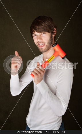 Man Holds Mallet stock photo, Confident bearded young man with mallet gives thumbs up by Scott Griessel