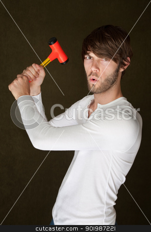 Serious Man with Mallet stock photo, Serious young Caucasian man raises a mallet by Scott Griessel