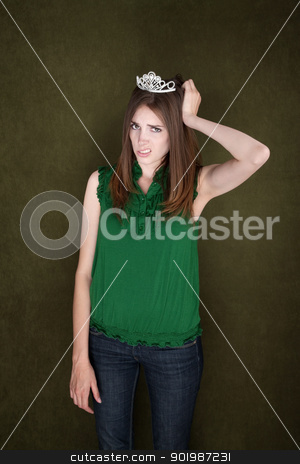 Unhappy Woman with Crown stock photo, Unhappy woman with a tiara holds her head by Scott Griessel