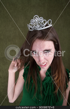 Disgusted Young Woman stock photo, Caucasian woman with tiara plays with her hair by Scott Griessel