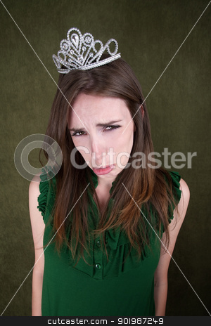 Pretty Young Woman Pouts stock photo, Cute young Caucasian woman with a crown tiara pouts by Scott Griessel