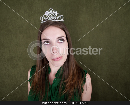 Young Woman with Tiara stock photo, Pretty Caucasian woman with small crown daydreams by Scott Griessel