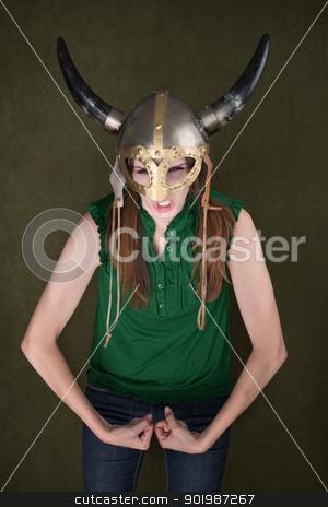 Woman in Viking Helmet Flexes Her Muscles stock photo, Tough-looking woman in Viking helmet flexes her biceps by Scott Griessel