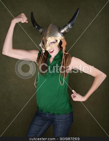 Woman in Viking Helmet Flexes Her Muscles stock photo, Young Female in Viking Helmet Flexes Her Muscles by Scott Griessel