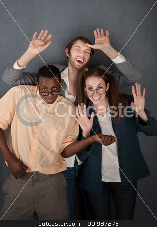 Three Dancing Nerds stock photo, Female and male geek dance while a slick salesman waves by Scott Griessel