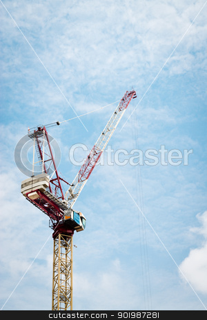Construction crane against cloudy sky stock photo, Construction crane against cloudy blue sky in Singapore by Iryna Rasko