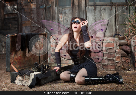Fairy With Loupe Glasses stock photo, Beautiful Caucasian fairy with loupe looks up by Scott Griessel