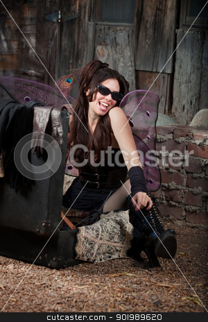 Happy Fairy stock photo, Happy Caucasian fairy with peacock feather relaxes on ground by Scott Griessel