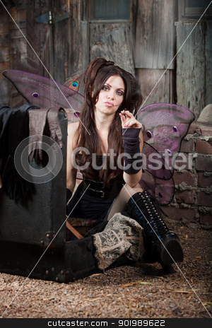 Smoking Fairy stock photo, Tough fairy smokes cigarette in a rustic location by Scott Griessel