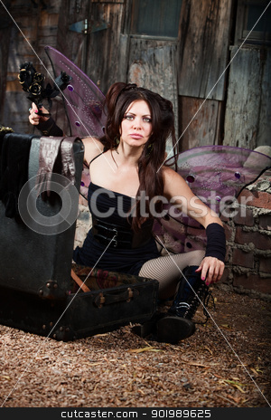 Frustrated Fairy Holds Black Roses stock photo, Frustrated Caucasian fairy holds black roses in rustic location by Scott Griessel