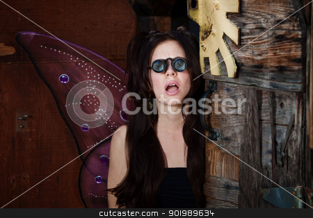 Fairy with Glasses stock photo, Pretty Caucasian fairy looks through loupe glasses with mouth open by Scott Griessel