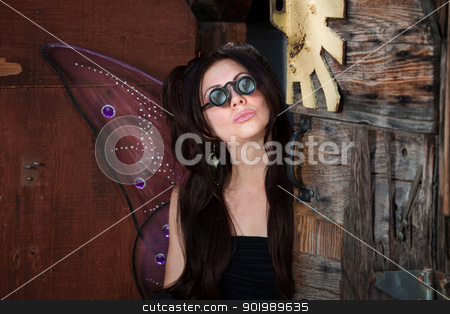 Fairy with Loupe stock photo, Pretty fairy with loupe glasses in rustic location by Scott Griessel