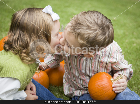 Cute Young Brother and Sister Kiss At the Pumpkin Patch stock photo, Cute Young Brother and Sister Children Kissing Among the Pumpkins at the Pumpkin Patch. by Andy Dean