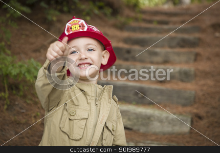 Adorable Child Boy with Fireman Hat Playing Outside stock photo, Happy Adorable Child Boy with Fireman Hat and Thumbs Up Playing Outside. by Andy Dean