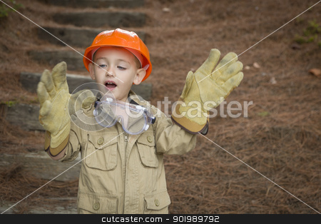 Adorable Child Boy with Big Gloves Playing Handyman Outside stock photo, Happy Adorable Child Boy with Big Gloves, Hard Hat and Goggles Playing Handyman Outside. by Andy Dean