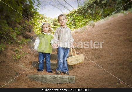 Two Children Walking Down Wood Steps with Basket Outside. stock photo, Adorable Brother and Sister Children Holding Hands Walking Down Wood Steps with Basket Outside. by Andy Dean