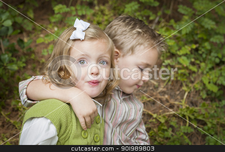 Adorable Brother and Sister Children Hugging Outside stock photo, Adorable Brother and Sister Children Hugging Each Other Outside. by Andy Dean