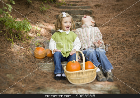 Brother and Sister Children Sitting on Wood Steps with Pumpkins stock photo, Cute Young Brother and Sister Children Sitting on Wood Steps Laughing with Pumpkins in a Basket. by Andy Dean