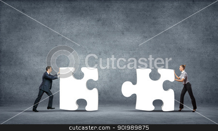 Piece of puzzle and business persons stock photo, Team of business people collaborate holding up jigsaw puzzle pieces as a solution to a problem by Sergey Nivens