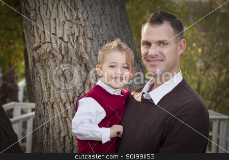 Handsome Father and Son in the Park stock photo, Handsome Father and Son Having Fun in the Park. by Andy Dean