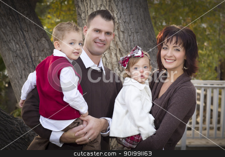 Young Attractive Parents and Children Portrait in Park stock photo, Young Attractive Parents and Children Portrait Outside in the Park. by Andy Dean
