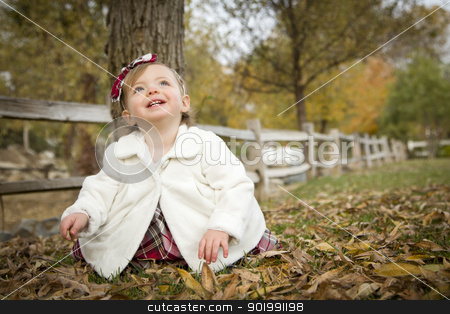 Adorable Baby Girl Playing in Park stock photo, Adorable Baby Girl Playing Outside in the Park. by Andy Dean