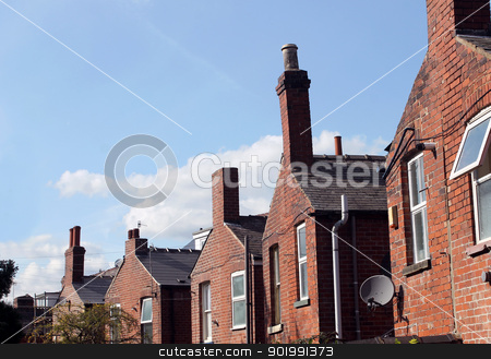 Back of English terraced houses stock photo, Back of English red brick terraced houses in city with blue sky background and copy space. by Martin Crowdy