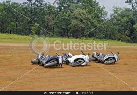 Three motorbikes on their side stock photo, Three generic motorbikes dropped on their side. Concept, play dead they might go away. Location of shot India by Kantilal Patel