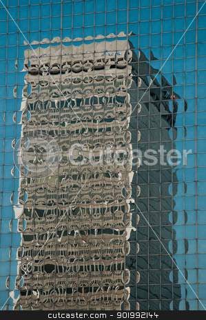 Reflection of a Building stock photo, A skyscraper's image is reflected in the windows of another building. by Joe Tabb