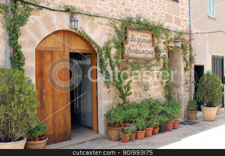 Italian pizza restaurant stock photo, Traditional Italian Pizzeria restaurant in Spain with ivy growing on wall. by Martin Crowdy