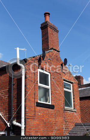 Old red brick house with chimney stock photo, Old red brick house with chimney, blue sky background. by Martin Crowdy